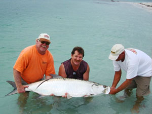 Happy Clients release Tarpon on the beach