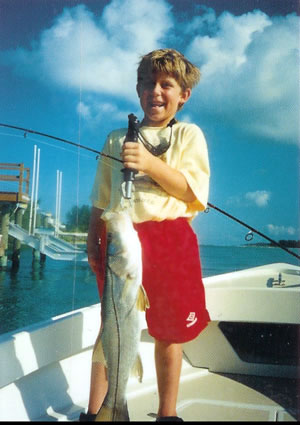 Proud young snook fisherman